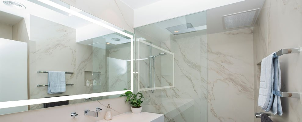 Verge lighted bathroom mirror, installed in a bathroom. Location South Yarra, Victoria, Australia.