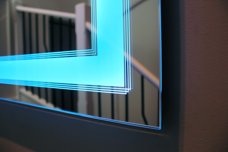 Art Deco Bathroom Lighted Mirror, blue light on, close up