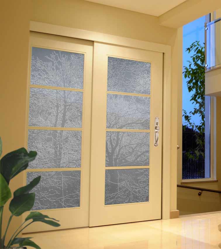 Tree design sandblasted onto transparent opaque glass doors