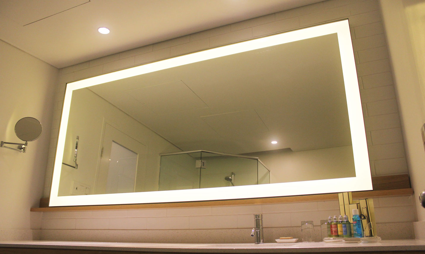 The Edge Metal Frame Lighted Mirror pictured in a 5 star hotel bathroom.