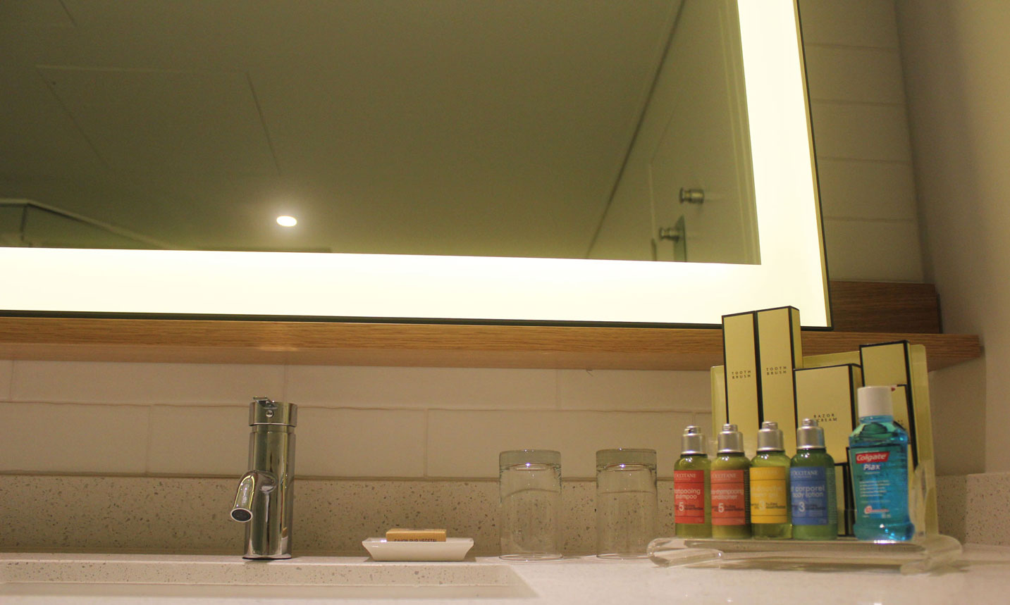 The Edge Metal Frame Lighted Mirror pictured in a 5 star hotel bathroom, corner view.